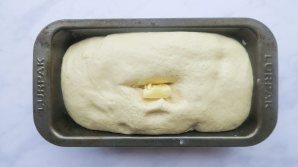 Slot a tbsp butter inside the dough