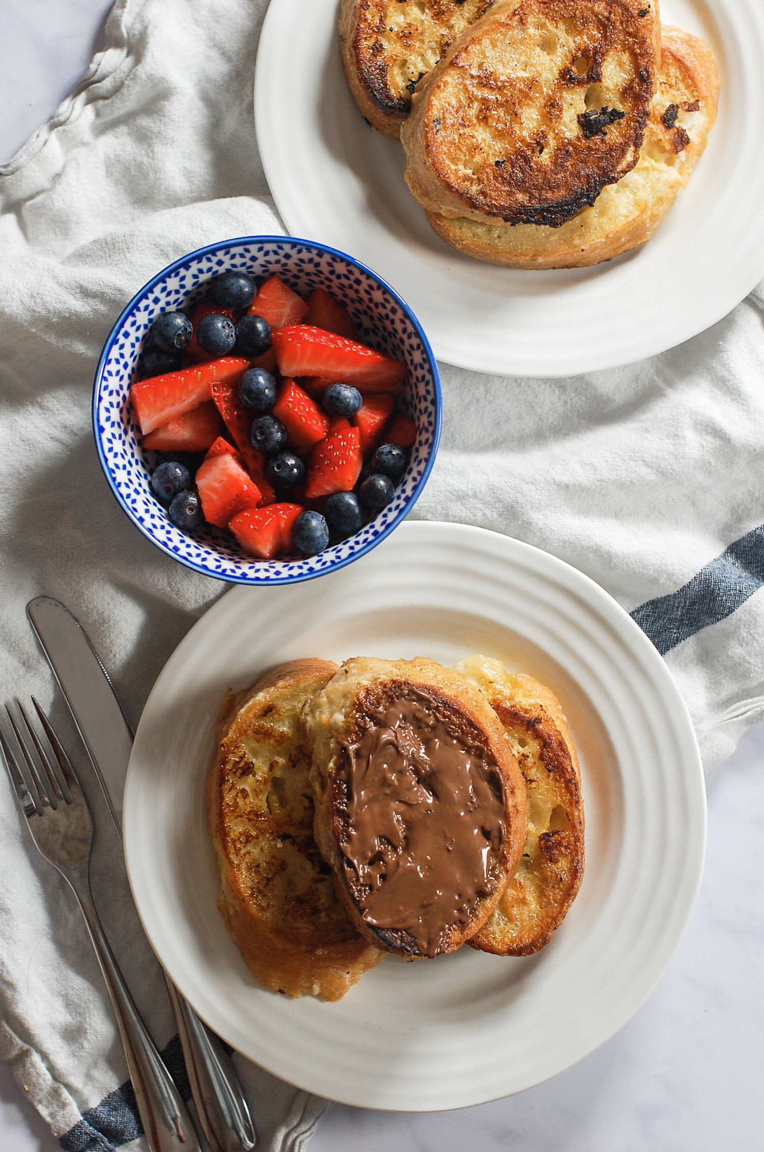 Spanish toasts torrijas and a bowl of fresh berries
