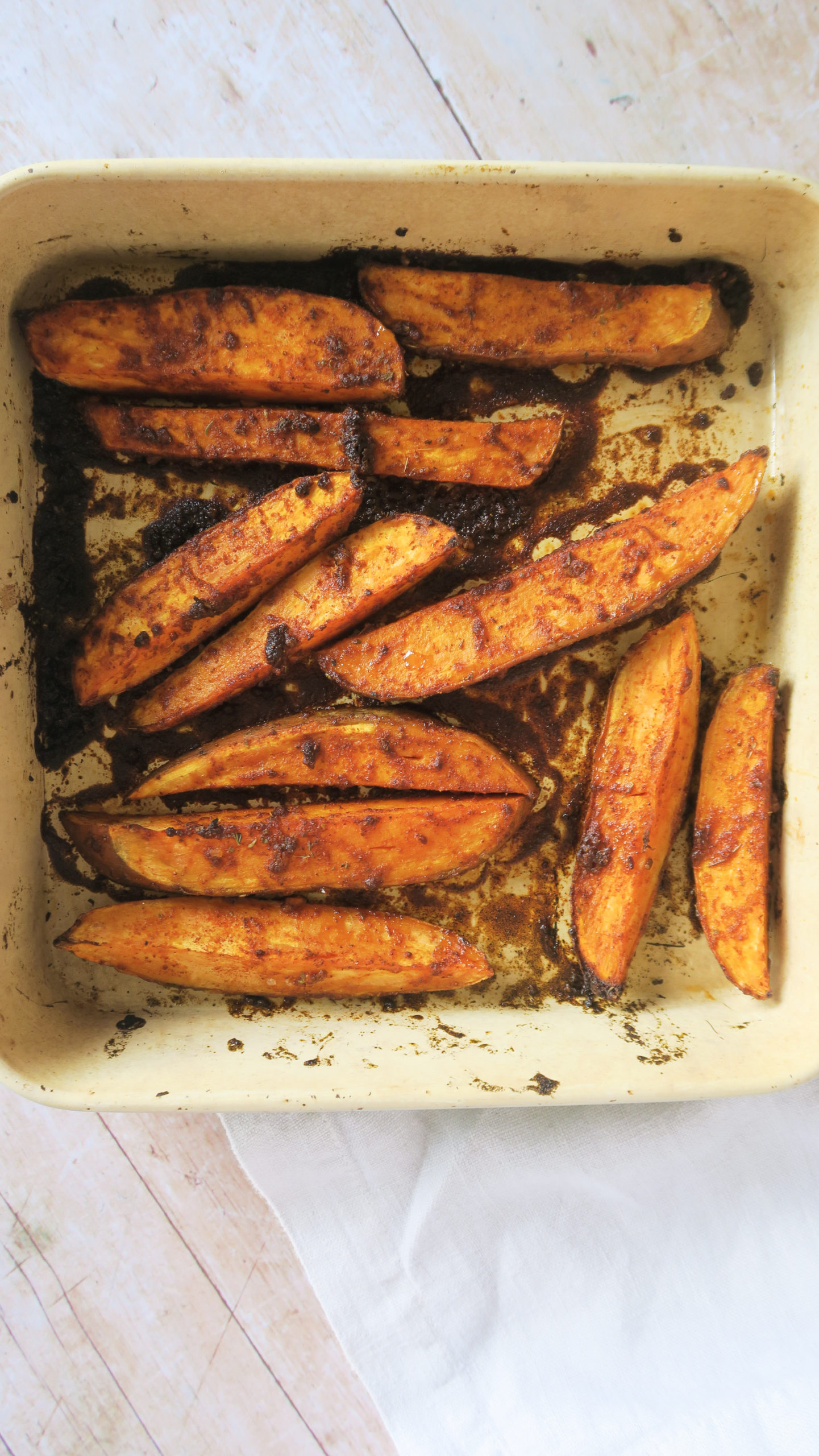 Sweet potato wedges roasted in a baking tray
