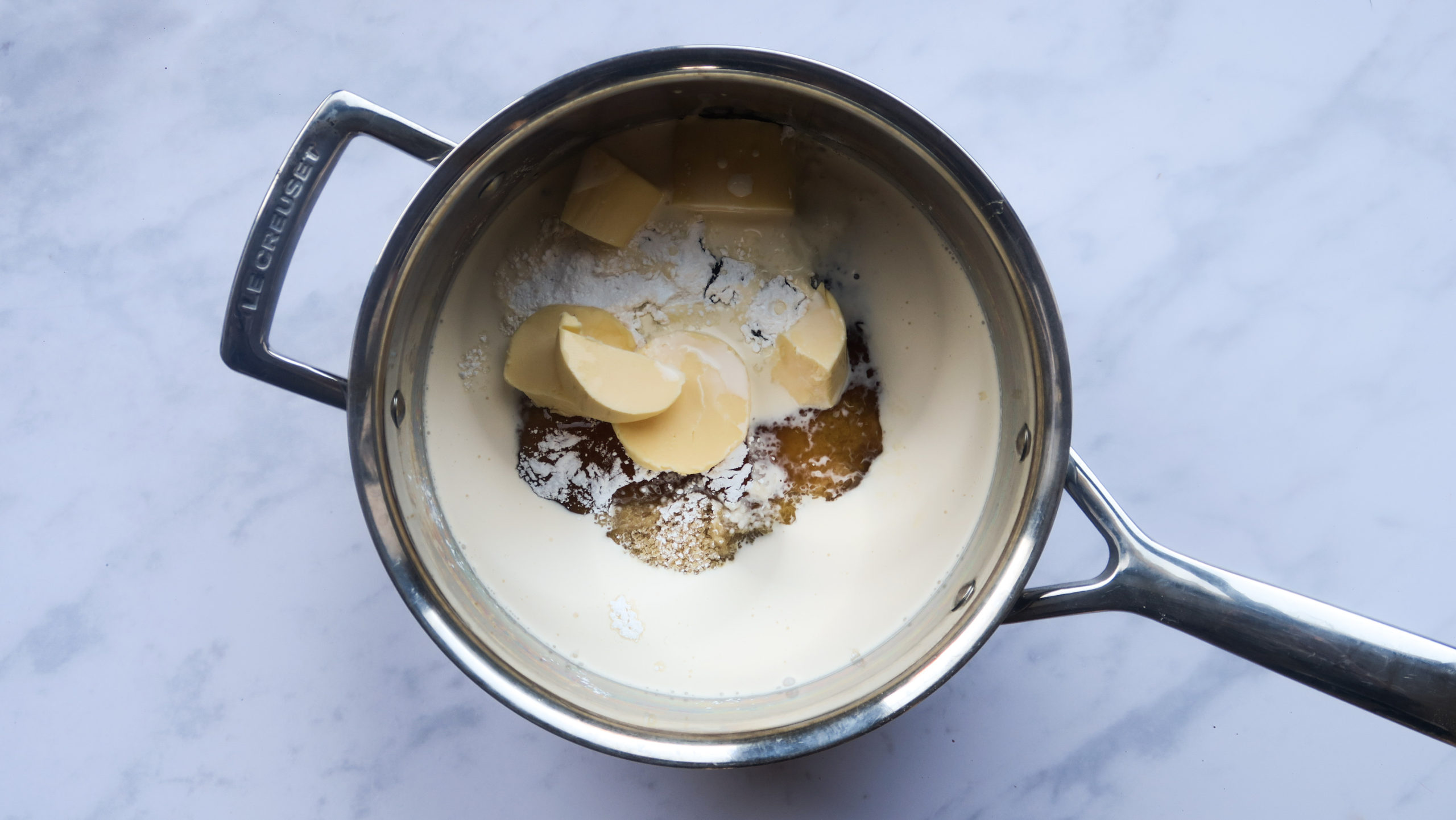 the dairy and sugar melting in a pan