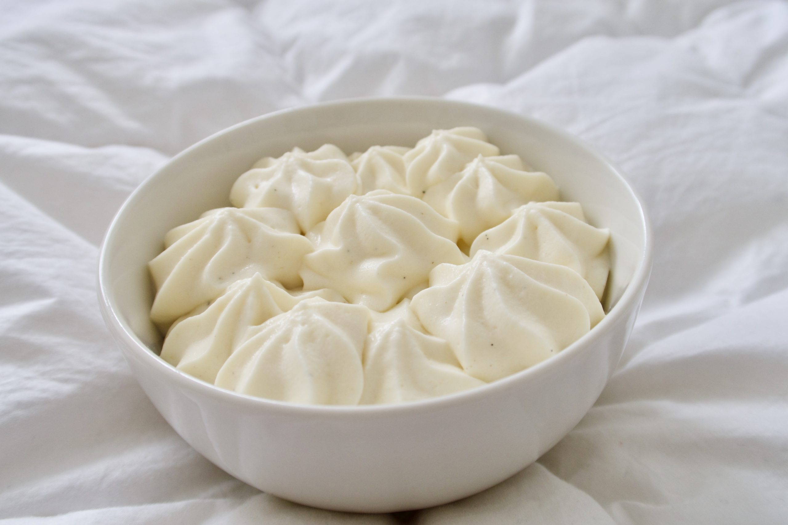 diplomat cream in a white bowl on a white background