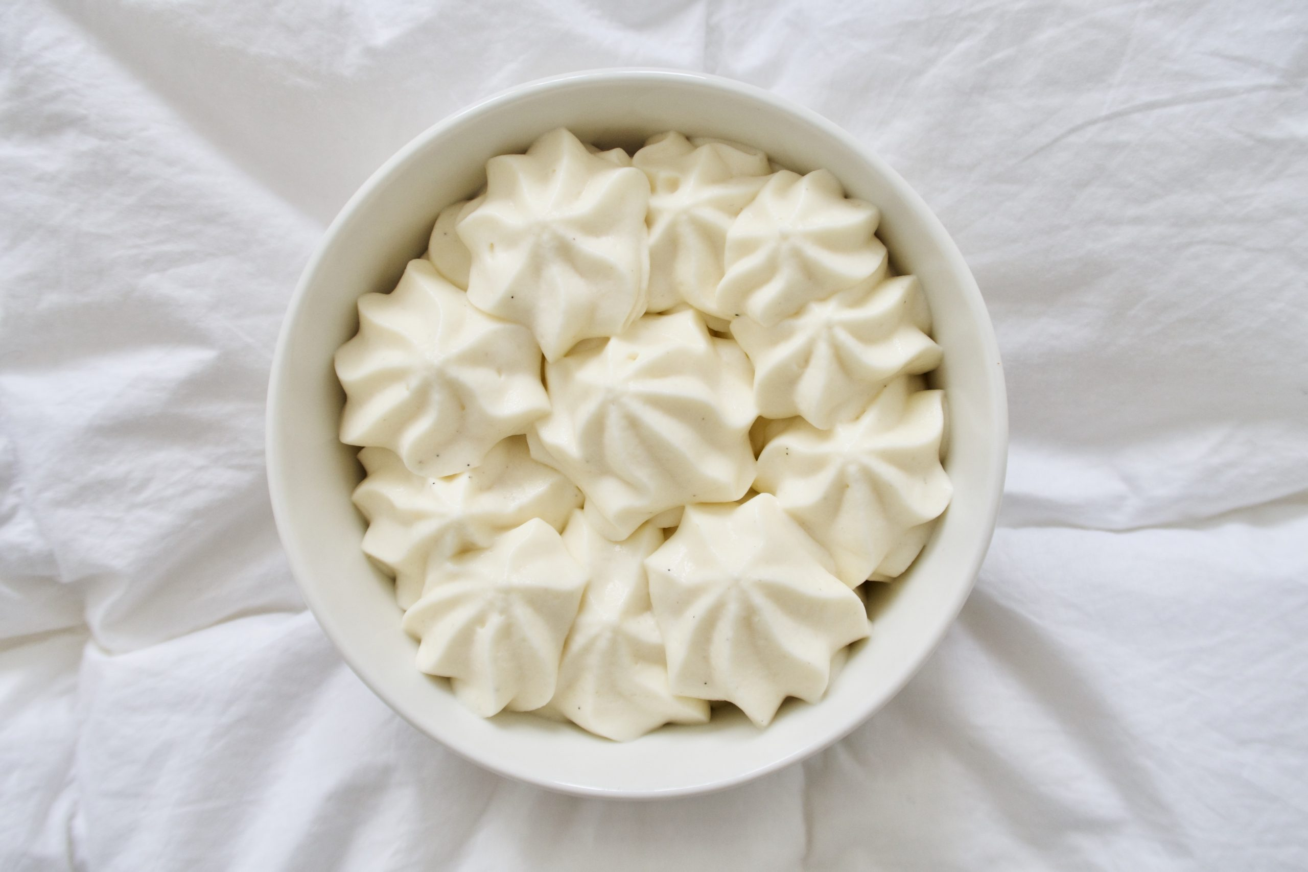A bowl of diplomat cream on a white background