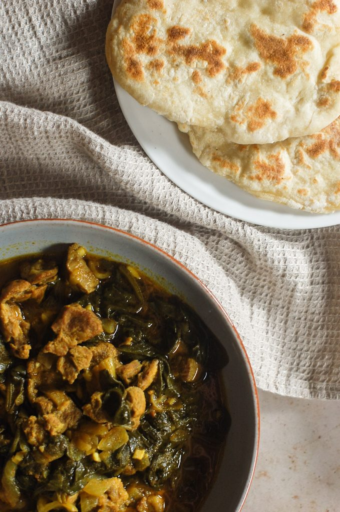 Lamb and spinach curry with naan bread